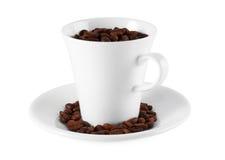 Kop en schotel en koffie Royalty-vrije Stock Foto's