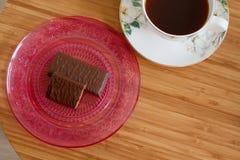 Kop koffie en chocoladesnoepjes Stock Fotografie