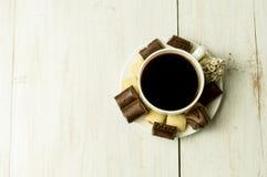 Kop koffie en snoepjes Stock Foto