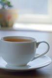 Kop met thee op een lijst Stock Foto's