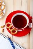 Kop thee en notitieboekje Royalty-vrije Stock Fotografie