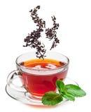 Kop thee en theeblaadjes. royalty-vrije stock foto