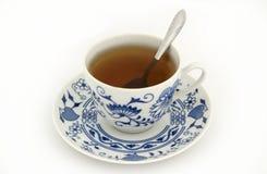 Kop thee met Lepel Stock Foto