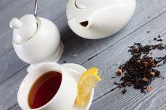Kop thee met theepot Hoogste mening Stock Foto