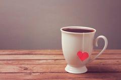Kop thee op houten lijst Het concept van de Moederdagviering Stock Afbeelding
