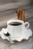 Kop van espresso en kaneel Stock Fotografie