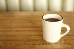 Kop van koffie bij diner Stock Foto's