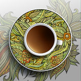 Kop van koffie en bloemenornament Stock Fotografie
