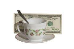 Kop van koffie en geld stock afbeeldingen