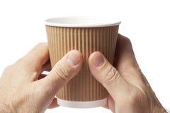 Kop van koffie in handen stock afbeeldingen