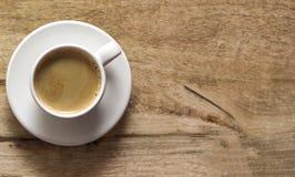 Kop van koffie Houten achtergrond De ruimte van het exemplaar Hoogste mening stock afbeelding