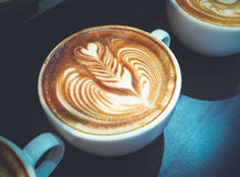 Kop van koffie latte art. Royalty-vrije Stock Foto's