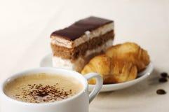 Kop van koffie met dessert Stock Foto