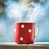 Kop van koffie met rook Stock Foto