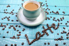 Kop van koffie op een houten achtergrond stock afbeelding