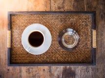 Kop van koffie op een houten lijst Stock Foto's