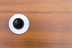 Kop van koffie op houten lijst Royalty-vrije Stock Foto's