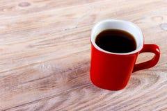Kop van koffie op houten lijst, hoogste mening Royalty-vrije Stock Afbeelding