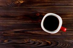 Kop van koffie op houten lijst, hoogste mening Stock Fotografie