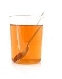Kop van thee met lepel Royalty-vrije Stock Foto's