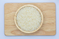 Kop van witte rijst op houten raad Stock Foto