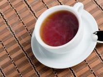 Kop van zwarte thee Stock Foto's
