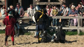 Crowd of people at the festival. 29.04.2018 - Kopachiv, Ukraine. Warriors fighting on festival of Medieval culture. Crowd of people at the festival. Park Kievan stock video footage