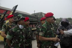 KOPASSUS HUMANITARIAN MISSION. A member of Indonesian Army's special force corpse Kopassus is preparing for humanitarian mission on eruption affected villages Royalty Free Stock Photography