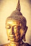 Kopf der goldenen Buddha-Statuenvignette Lizenzfreies Stockfoto