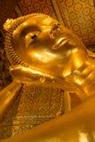 Kopf des stützenden Buddhas. Bangkok, Thailand Stockbild