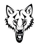 Kopf eines Wolfs mit Stammes- Stockfoto