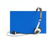 Kopfhörer auf Blau Lizenzfreies Stockfoto