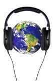 Kopfhörer auf der Welt Lizenzfreies Stockfoto