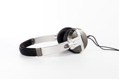Kopfhörer auf weißem Hintergrund Stockbilder