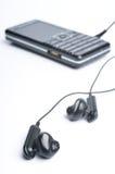 Kopfhörer mit G/M Lizenzfreie Stockfotos