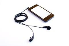 Kopfhörer und handphone Lizenzfreie Stockfotografie
