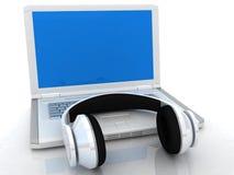 Kopfhörer und Laptop Lizenzfreie Stockfotografie