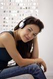 Kopfhörerfrau Stockfotos