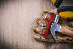 Kopfhörertischlerhammer-Lederschutzhandschuhe und schützende glas Lizenzfreie Stockfotos