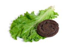Kopfsalat oder Plätzchen und Diät oder Nachtisch getrennt Stockbild