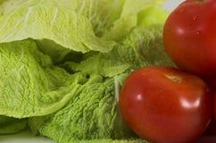 Kopfsalat und Salat Stockfotos