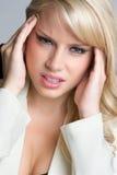 Kopfschmerzen-Geschäftsfrau Stockbilder