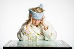 Kopfschmerzenmädchen Stockfotos