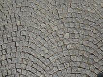 Kopfstein entsteint die Straße, die gerundeten Hintergrund pflastert Lizenzfreie Stockbilder