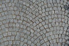 Kopfstein entsteint die Straße, die gerundeten Hintergrund pflastert Lizenzfreies Stockfoto
