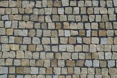 Kopfstein entsteint die Straße, die Hintergrund pflastert Stockbilder