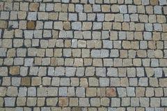 Kopfstein entsteint die Straße, die Hintergrund pflastert Stockfoto