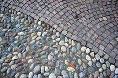 Kopfstein- und Granitpflasterungsbeschaffenheit Stockfotografie