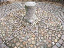 Kopfstein windrose stockbilder