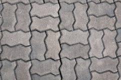 Kopfsteinhintergrund, Stein, der Beschaffenheit pflastert Stockfotos